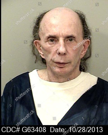 This mugshot provided by the California Department of Corrections and Rehabilitation shows rock 'n' roll music producer Phil Spector, mostly bald with just a bit of hair, and completely free of the huge hair that was so striking during his murder trial. In a June 2017 mugshot the 76-year-old music producer is smiling broadly, completely bald and wearing hearing aids on both ears. He was convicted in 2009 of killing actress Lana Clarkson, and is serving a sentence of 19 years to life