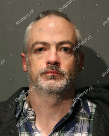 This booking photo provided by the Chicago Police Department shows Wyndham Lathem on . Lathem, a Northwestern University professor, and Andrew Warren, an Oxford University financial officer, have been charged with first-degree murder in the death of Trenton James Cornell-Duranleau, a Michigan native who had been working in Chicago. Authorities say Cornell-Duranleau suffered more than 40 stab wounds to his upper body during the July attack in Lathem's high-rise Chicago condo. Lathem and Warren surrendered peacefully to police in California on Aug. 4 after an eight-day manhunt