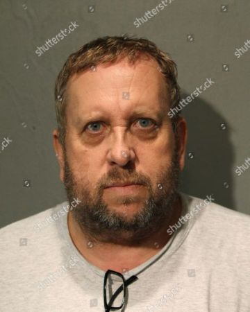 This booking photo provided by the Chicago Police Department shows Andrew Warren on . Warren, an Oxford University financial officer, and Wyndham Lathem, a Northwestern University professor, have been charged with first-degree murder in the death of Trenton James Cornell-Duranleau, a Michigan native who had been working in Chicago. Authorities say Cornell-Duranleau suffered more than 40 stab wounds to his upper body during the July attack in Lathem's high-rise Chicago condo. Lathem and Warren surrendered peacefully to police in California on Aug. 4 after an eight-day manhunt