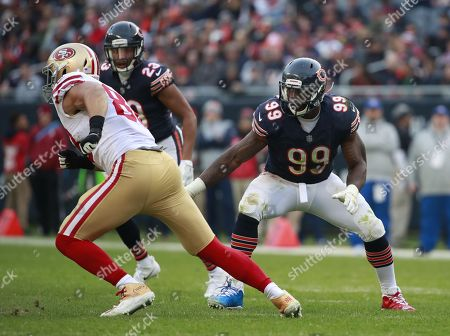 Chicago Bears linebacker Lamarr Houston (99) defends against the San Francisco 49ers during an NFL football game, in Chicago. The 49ers won the game 15-14
