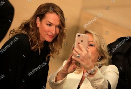 Stock Image of A woman takes a selfie with model Tatjana Patitz, left, at Chanel's pre-fall Metiers d'Art fashion show in the new Elbphilharmonie concert house in Hamburg, southern Germany