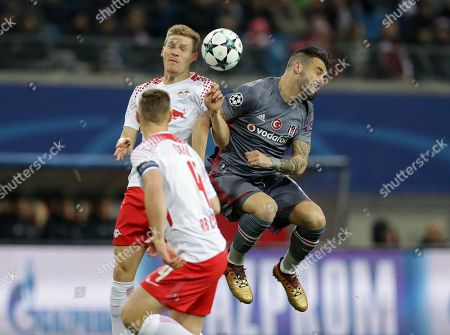 Leipzig's Marcel Halstenberg, left, and Besiktas' Alvaro Negredo go for a header during the Champions League Group G soccer match between RB Leipzig and Besiktas JK in Leipzig, Germany