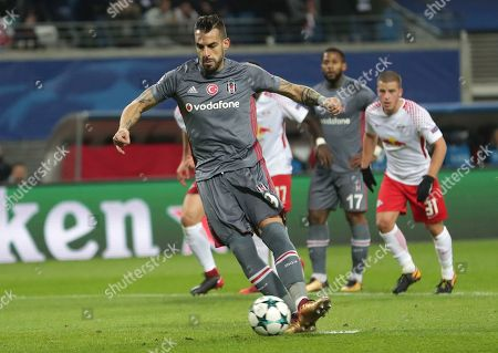 Besiktas' Alvaro Negredo scores the opening goal from the penalty spot during the Champions League Group G soccer match between RB Leipzig and Besiktas JK in Leipzig, Germany