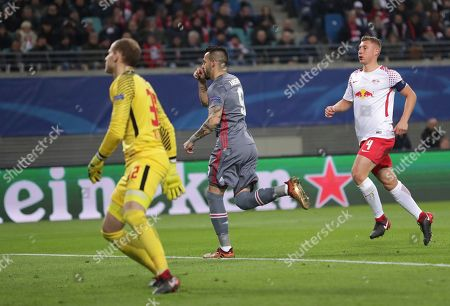 Besiktas' Alvaro Negredo, center, celebrates after scoring the opening goal during the Champions League Group G soccer match between RB Leipzig and Besiktas JK in Leipzig, Germany