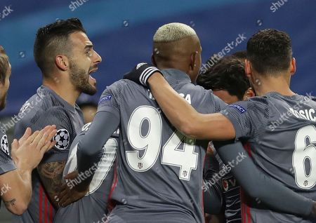 Besiktas' Alvaro Negredo, left, celebrates after scoring the opening goal during the Champions League Group G soccer match between RB Leipzig and Besiktas JK in Leipzig, Germany