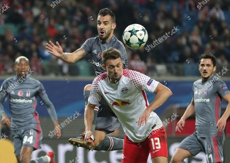 Leipzig's Stefan Ilsanker, front, and Besiktas' Alvaro Negredo challenge for the ball during the Champions League Group G soccer match between RB Leipzig and Besiktas JK in Leipzig, Germany