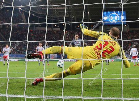 Besiktas' Alvaro Negredo, back, scores the opening goal past Leipzig goalkeeper Peter Gulacsi during the Champions League Group G soccer match between RB Leipzig and Besiktas JK in Leipzig, Germany