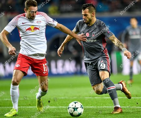Leipzig's Stefan Ilsanker (L) and Besiktas Istanbul's Alvaro Negredo (R) in action during the UEFA Champions League group G soccer match between RB Leipzig and Besiktas Istanbul in Leipzig, Germany, 06 December 2017.