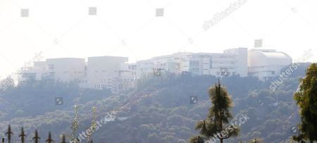 Stock Picture of The Getty Center lies shrouded in smoke as seen from the Bel Air district of Los Angeles after the Skirball wildfire swept through . The Getty Center, the $1 billion home to the J. Paul Getty Museum and related organizations, stands on the west side of Sepulveda Pass. The fire erupted on the east side of the pass, but the plume of smoke curled west, over the Getty. But the Getty would have been prepared even if flames had threatened. Officials have described how fire protection was designed into the facility by architect Richard Meier, including the thickness of the walls and doors to compartmentalize any fire