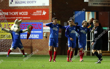 Gwion Edwards of Peterborough United celebrates his goal with team-mates Andrew Hughes and Jack Marriott