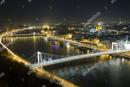 Elizabeth Bridge (foreground), the Chain Bridge, across River Danube, a Ferris wheel and St. Stephen Basilica behind it are  illuminated at night in Budapest, Hungary, 28 November 2017. Budapest, the capital of Hungary, is one of the most culturally important metropolises in Eastern Europe and home to numerous UNESCO World Heritage Sites.