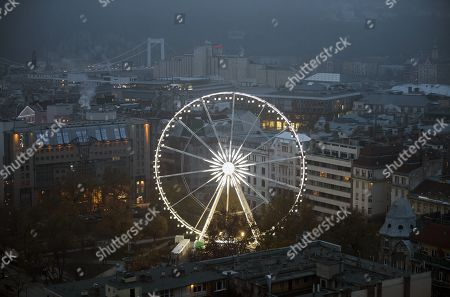 Stock Photo of A Ferris wheel is  illuminated at night in Elizabeth Square in downtown Budapest, Hungary, 24 November 2017. Budapest, the capital of Hungary, is one of the most culturally important metropolises in Eastern Europe and home to numerous UNESCO World Heritage Sites.