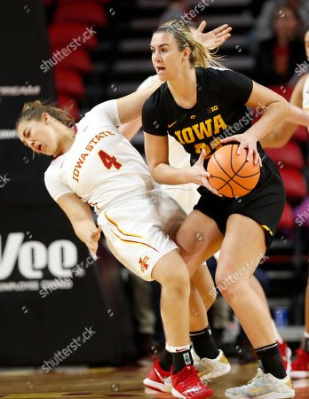 Hannah Stewart, Rae Johnson. Iowa State guard Rae Johnson, left, is fouled by Iowa forward Hannah Stewart during the first half of an NCAA college basketball game, in Ames, Iowa