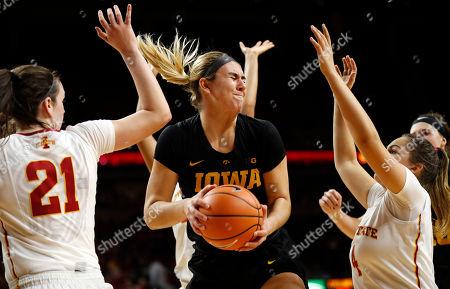 Bridget Carleton, Rae Johnson, Hannah Stewart. Iowa forward Hannah Stewart, center, grabs a rebound between Iowa State's Hannah Stewart, left, and Rae Johnson, right, during the second half of an NCAA college basketball game, in Ames, Iowa