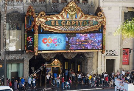 """This photo shows crowds lining up at the El Capitan Theatre for a screening of the Disney Pixar film """"Coco"""" in Los Angeles. The film, a contender for an Oscar for best animated feature, is the latest from Pixar, the animation studio co-founded by John Lassater. He's currently on a """"sabbatical"""" following his admission of inappropriate behavior"""