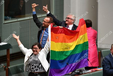 MPs Cathy McGowan (L), Adam Brandt (C) and Andrew Wilkie (R) celebrate the passing of the Marriage Amendment Bill in the House of Representatives at Parliament House in Canberra, Australia, 07 December 2017. The passage of the bill effectively legalizes same-sex marriage in Australia.