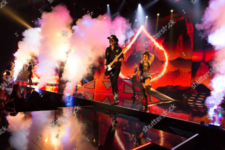 Stock Image of A star performs Ace of Spades by Lemmy from Motorhead