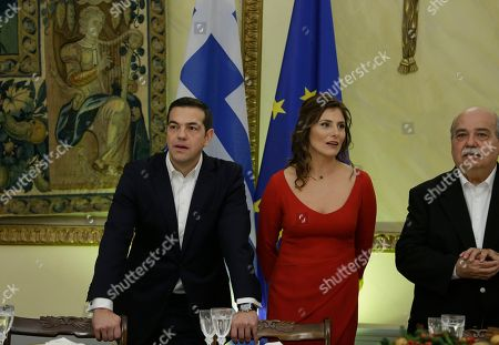 Alexis Tsipras, Betty Baziana. Greece's Prime Minister Alexis Tsipras, left and his partner Betty Baziana, stand prior to an official dinner for Turkey's President Recep Tayyip Erdogan hosted by Greece's President Prokopis Pavlopoulos, in Athens, . Greek Parliament Speaker Nikos Voutsis is seen on the right. The presidents engaged in a thinly-veiled verbal spat over the treaty and the Muslim minority in northeastern Greece, when they met earlier in the day, a tense start for the first official visit by a Turkish president to Greece in six decades
