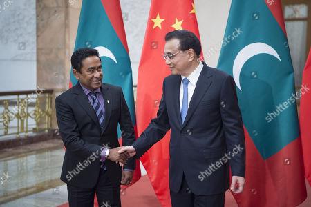 Li Keqiang and Abdulla Yameen