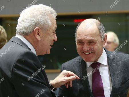 EU Commissioner for migration and home affairs Dimitris Avramopoulos (L) chats with Austrian Interior Minister Wolfgang Sobotka during a Justice and Home Affairs Council in Brussels, Belgium, 07 December 2017.