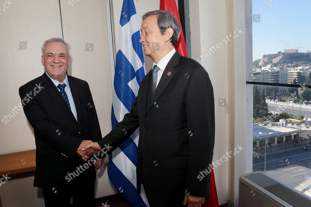 Greek vice-president Yiannis Dragasakis (L) shake hands with China?s Vice Premier Ma Kai(R) during their meeting, in Athens, Greece, 07 December 2017. The focus of talks during Ma Kai's visit to Greece will be on new technology, tourism and agri-food products.