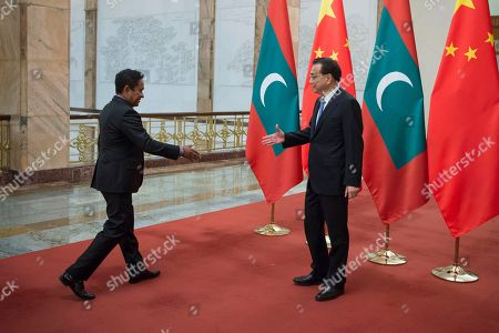 Li Keqiang, Abdulla Yameen. Chinese Premier Li Keqiang, right, greets Maldives President Abdulla Yameen at the Great Hall of the People in Beijing