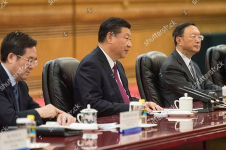 Xi Jinping. China's President Xi Jinping, center, talks with Maldives' President Abdulla Yameen, during a meeting at the Great Hall of the People in Beijing