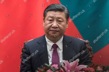China's President Xi Jinping waits for the start of a signing ceremony with Maldives' President Abdulla Yameen at the Great Hall of the People in Beijing