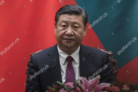 China's President Xi Jinping waits during a signing meeting with Maldives President Abdulla Yameen at the Great Hall of the People in Beijing, China, 07 December 2017.
