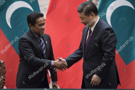 Maldives President Abdulla Yameen (L) shakes hand of China's President Xi Jinping after a signing meeting at the Great Hall of the People in Beijing, China, 07 December 2017.
