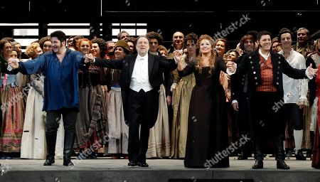 """From left, tenor Yusif Eyvazov, conductor Riccardo Chailly, soprano Anna Netrebko and baritone Luca Salsi acknowledge the applause of the audience at the end of La Scala opera house's gala season opener, Umberto Giordano's opera """"Andrea Chernier"""", at the Milan La Scala theater, Italy, . The season-opener Thursday, held each year on the Milan feast day St. Ambrose, is considered one of the highlights of the European cultural calendar"""