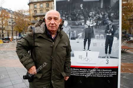 "French photographer and director Raymond Depardon unveils an exhibition of his Olympics Games photos as part of Reporters Sans Frontieres book for the liberty of the press, in front of Paris city hall, in Paris, France, . The exhibition entitled ""Les JO de Raymond Depardon"" presents his photos of the Olympic Games between 1964 and 1980. Caption of the picture at right : ""US Bob Beamon receives the gold medal after he breaks the world record in the long jump by nearly two feet during the 1968 Mexico City Olympic Games"