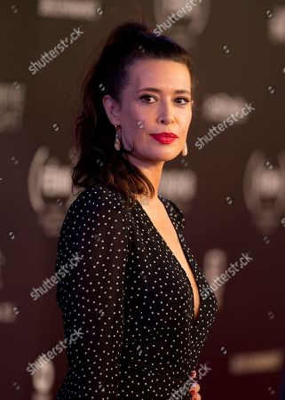 Colombian actress Angie Cepeda poses for photographers on her red carpet walk as she arrives for the Fenix Iberoamerican Film Awards ceremony at the Esperanza Iris Theater in Mexico City