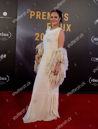 Actress Cristina Umana poses for photographers on her red carpet walk as she arrives for the Fenix Iberoamerican Film Awards ceremony at the Esperanza Iris Theater in Mexico City
