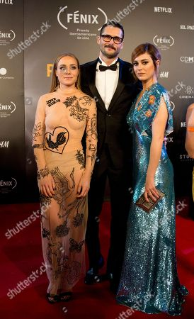 Cremonte, Sergio Mur, Blanca Suarez. Spain actors Angela Cremonte, from left, Sergio Mur, and Blanca Suarez, pose for photographers on their red carpet walk as they arrive for the Fenix Iberoamerican Film Awards ceremony at the Esperanza Iris Theater in Mexico City