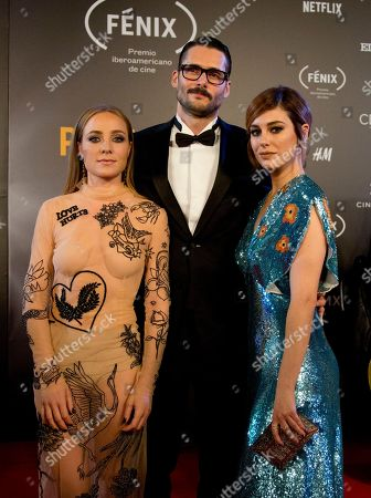 Blanca Suarez, Sergio Mur, Blanca Suarez. Spain actors Angela Cremonte, from left, Sergio Mur, and Blanca Suarez, pose for photographers on their red carpet walk as they arrive for the Fenix Iberoamerican Film Awards ceremony at the Esperanza Iris Theater in Mexico City