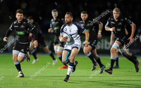 Aaron Cruden - Montpellier fly half splits the Glasgow defence as Ali Price (L) gives chase. Glasgow Warriors v Montpellier Herault Rugby, European Rugby Champions Cup, Scotstoun Stadium, Scotland, Friday 8th December 2017. ***Please credit: ©Fotosport/David Gibson***
