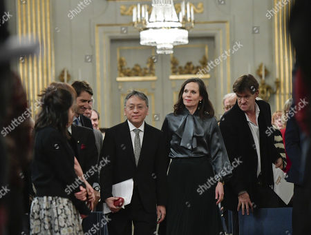 Nobel literature leaurate Kazuo Ishiguro (C-L) and Swedish Academy permanet secretary Sara Danius (C-R) arrive to the traditional lecture at the Royal Swedish Academy in Stockholm, Sweden, 07 December 2017. The Nobel Prize Award Ceremony and Banquet will take place on 10 December.