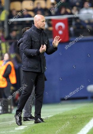 Stock Photo of Macabi's coach Jordi Cruyff gesture to the players during their UEFA Europa League group A soccer match between Villarreal and Maccabi Tel Aviv at the Ceramica stadium in Villarreal, Spain
