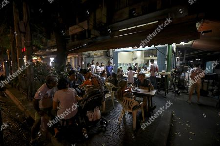 People eat at Raan Jae Fai restaurant, Thailand's first street style food Michelin star restaurant in Bangkok, Thailand, 08 December 2017. Raan Jae Fai restaurant, run by Chef Jay Fai and popular both for Jay Fai's oversized glasses as well as its fried drunken noodles and crab omelette (1,000THB or 26 euro), was awarded on 07 December 2017 a Michelin star, making it the first street food restaurant in Thailand to be awarded a Michelin star.