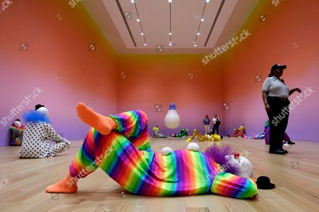 An exhibit by artist Ugo Rondinone, of Switzerland, titled Vocabulary of Solitude featuring 45 life-size clowns, is shown at The Bass museum, in Miami Beach, Fla. The Bass reopened recently after a two-year renovation and is part of events related to Art Basel Miami Beach