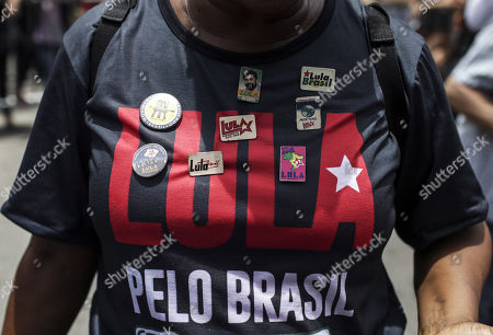 A woman wears a t-shirt of the 'Lula pelo Brasil' march (Lula for Brazil) during the visit of former Brazilian President Luis Inacio Lula da Silva to the city of Duque de Caxias, in the Baixada Fluminense, Rio de Janeiro State, Brazil, 07 December 2017. Lula da Silva visited the city, one of the most violence of Rio, during the final run to look for support for an eventual presidential candidacy next year.