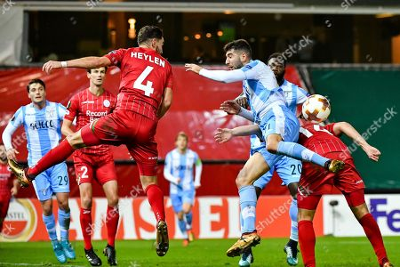 Zulte Waregem's Michael Heylen, left, and Sandy Walsh, right, challenge Lazio's Luca Crecco during a Europa League group K soccer match between Zulte Waregem and Lazio at the Regenboog stadium in Waregem, Belgium, on