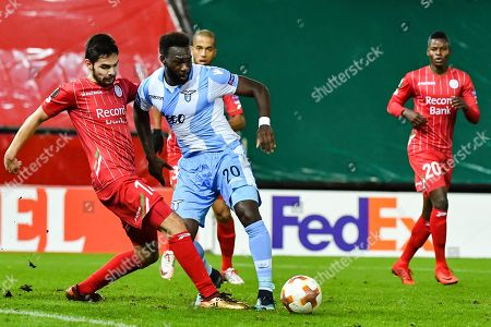 Zulte Waregem's Sandy Walsh, left, challenges Lazio's Felipe Caicedo during a Europa League group K soccer match between Zulte Waregem and Lazio at the Regenboog stadium in Waregem, Belgium, on
