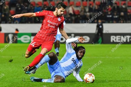Zulte Waregem's Sandy Walsh, left, challenges Lazio's Jordan Lukaku during a Europa League group K soccer match between Zulte Waregem and Lazio at the Regenboog stadium in Waregem, Belgium, on