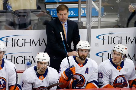 New York Islanders head coach Doug Weight stands behind his bench during the third period of an NHL hockey game against the Pittsburgh Penguins in Pittsburgh, . The Penguins won 4-3 in overtime