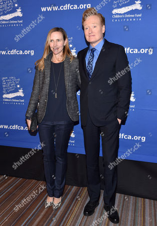 Stock Photo of Conan O'Brien and Liza Powel O'Brien