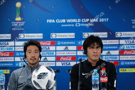 Takafumi Hori, Yuki Abe. Japan's Urawa Reds head coach Takafumi Hori, right, listens to question during a press conference with his player Yuki Abe at Zayed sport city in Abu Dhabi, United Arab Emirates, . Urawa Reds will play Al Jazira Club in a second round of the FIFA Club World Cup soccer tournament