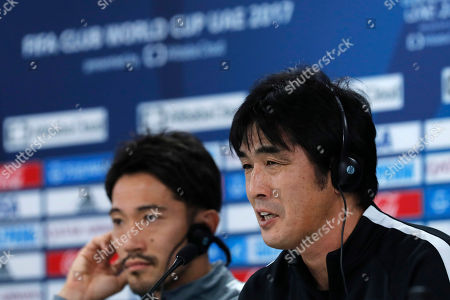 Takafumi Hori, Yuki Abe. Japan's Urawa Reds head coach Takafumi Hori, right, speaks during a press conference with his player Yuki Abe at Zayed sport city in Abu Dhabi, United Arab Emirates, . Urawa Reds will play Al Jazira Club in a second round of the FIFA Club World Cup soccer tournament