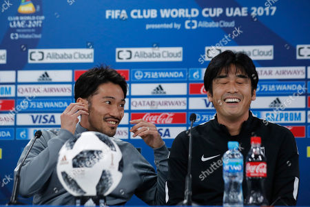 Takafumi Hori, Yuki Abe. Japan's Urawa Reds head coach Takafumi Hori, right, laughs with his player Yuki Abe before their press conference at Zayed sport city in Abu Dhabi, United Arab Emirates, . Urawa Reds will play Al Jazira Club in a second round of the FIFA Club World Cup soccer tournament
